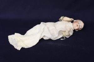 A 1900's porcelain baby doll.