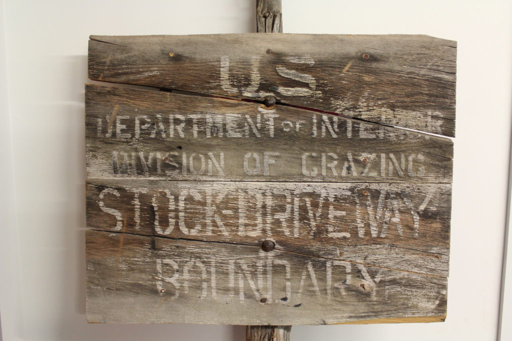 A Division of Grazing service sign made of milled lumber on a juniper post. The Division of Grazing was renamed then merged with the General Land Office to form the BLM in 1946.