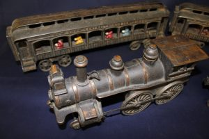 A cast iron toy train set.
