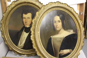 A couples matched portraits.