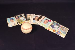 Baseball card collection and autographed ball.