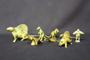 Cast bronze animal and dinosaur figures.
