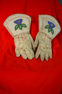The Ute people are known for their impressive beadwork like you see here on these leather gloves.