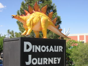 The state dinosaur welcomes you to Dinosaur Journey.