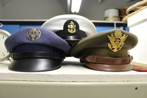 US military dress hats. The Air Force, the Navy and the Army are represented here.